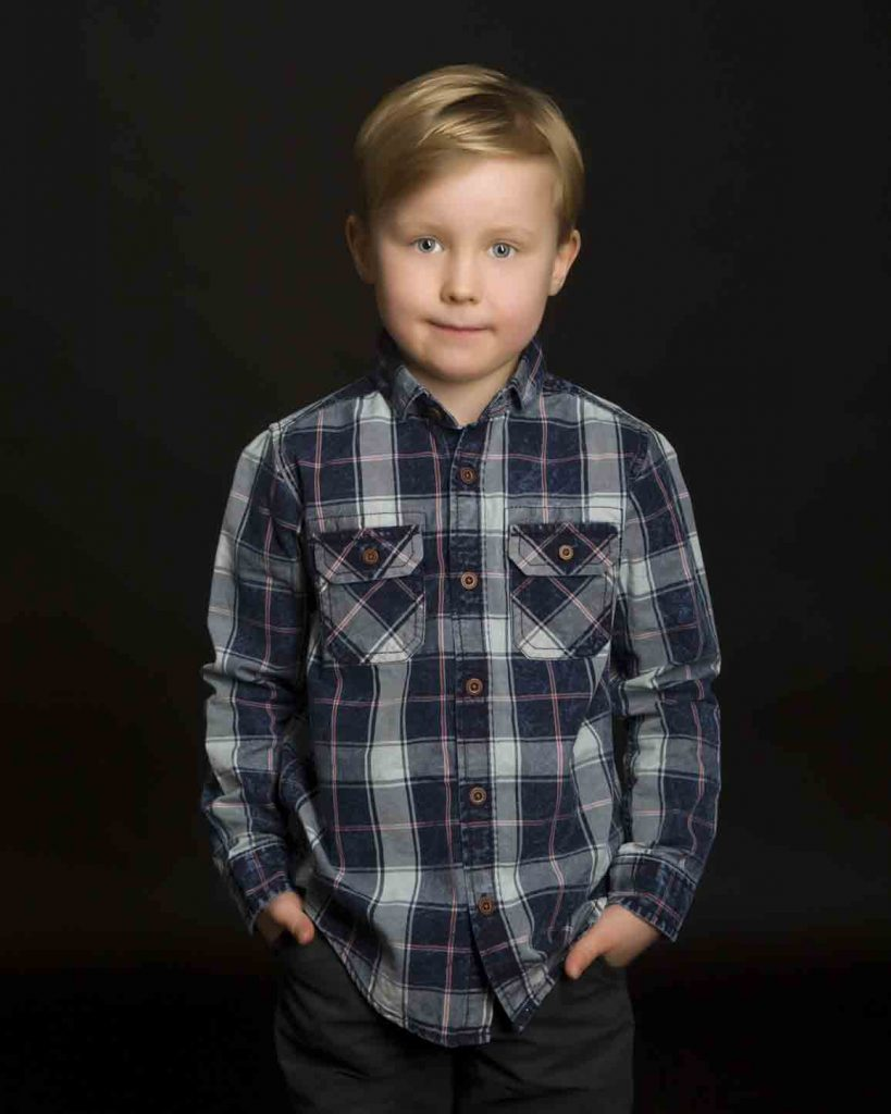 boy with check shirt in studio