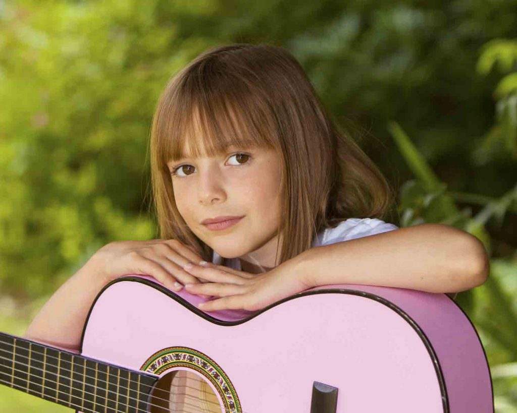 girl with guitar outside