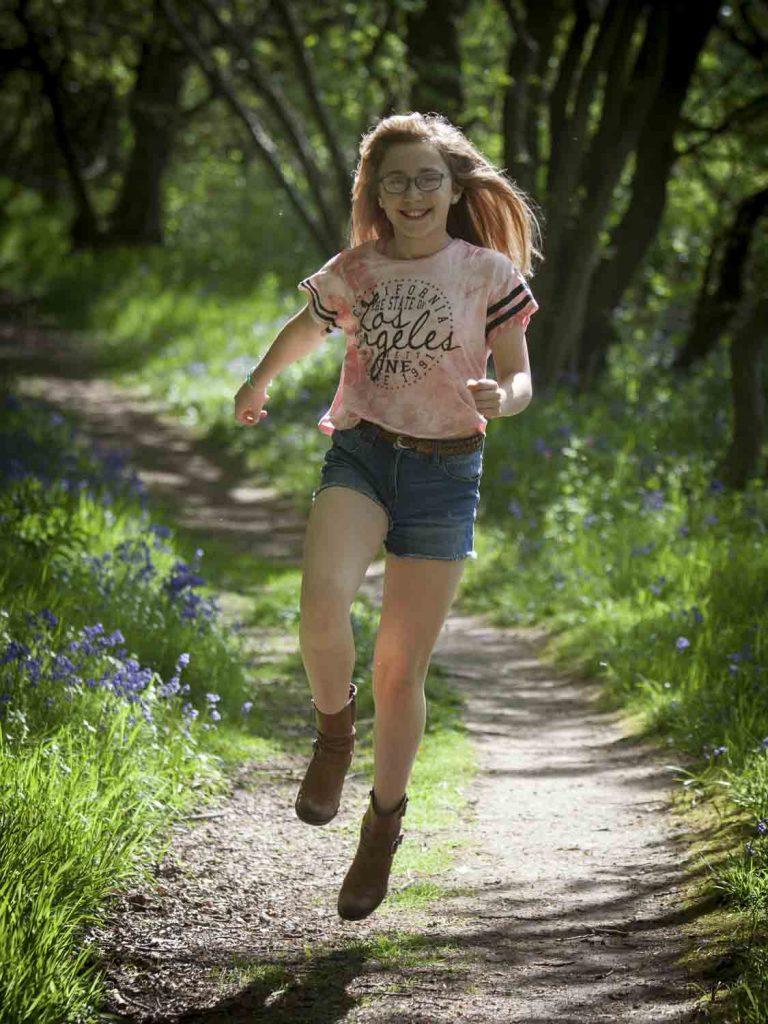 girl running through woods