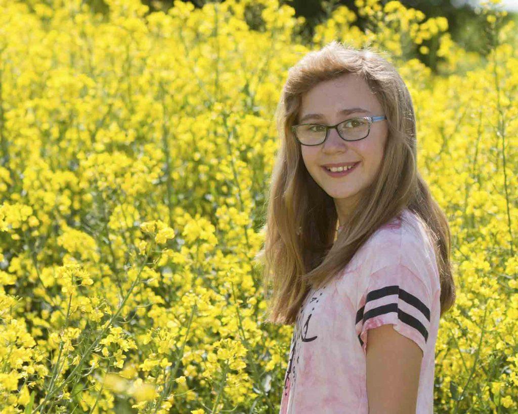 girl in oilseed field