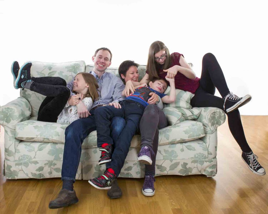 family on a sofa in a studio