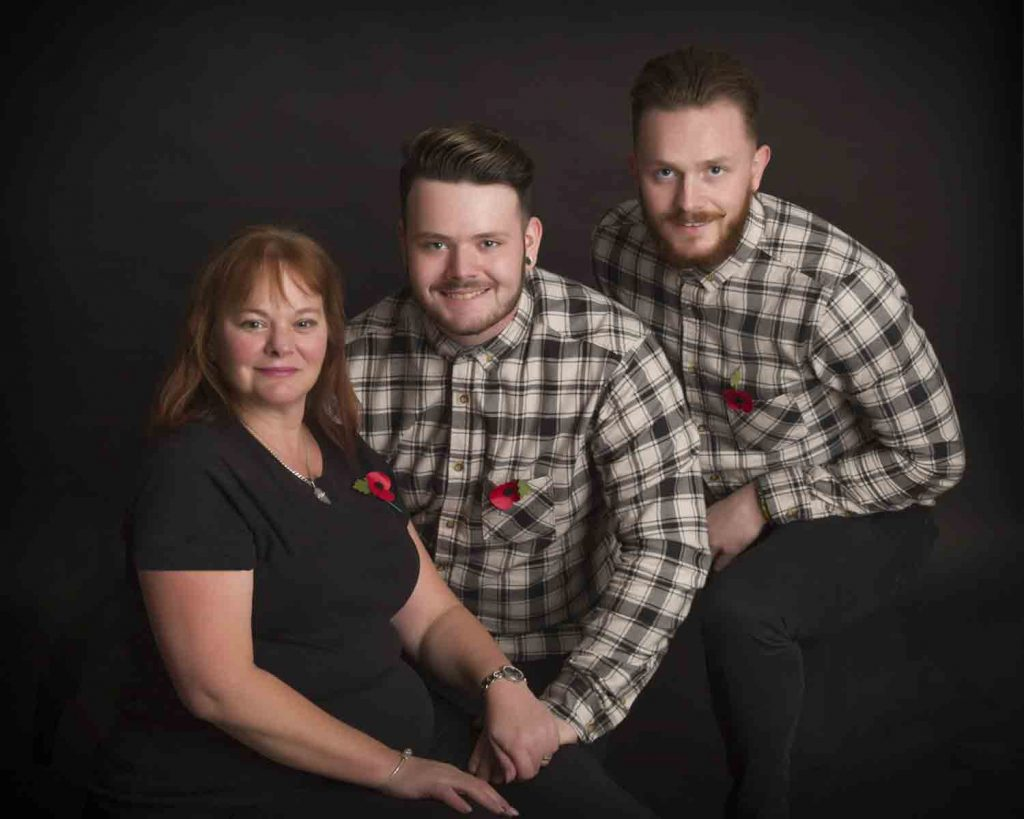 mother with sons wearing poppies