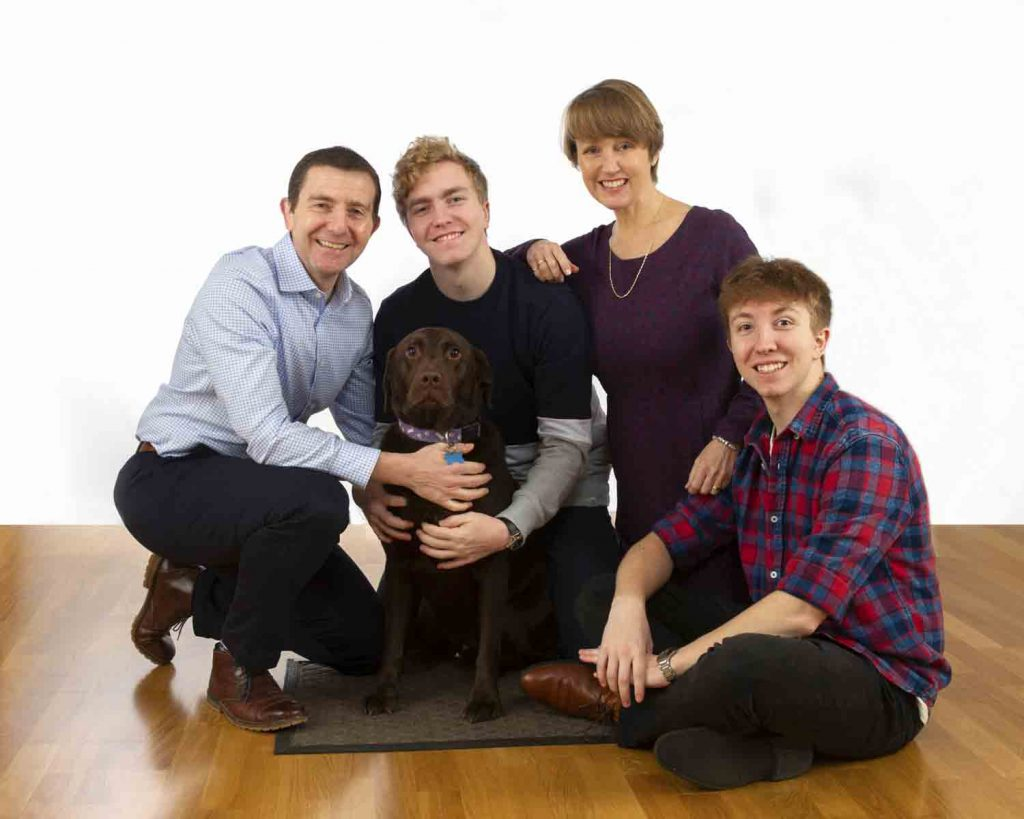 family with a dog in a studio