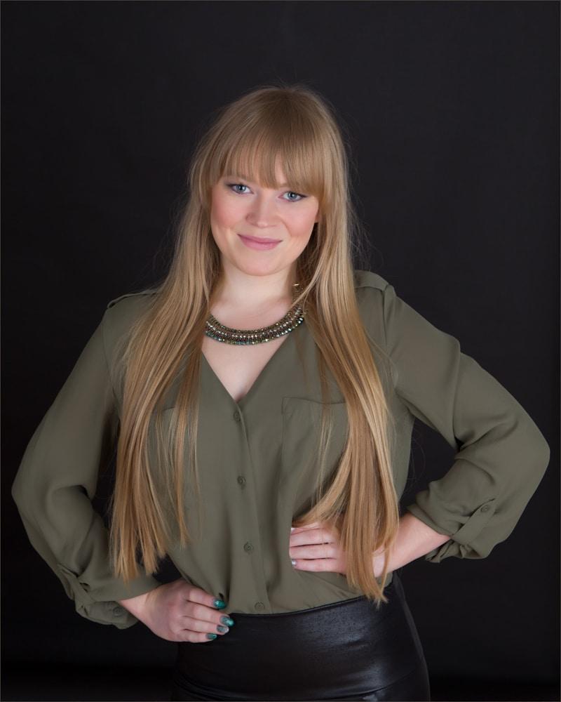 portfolio - girl in studio against a dark background