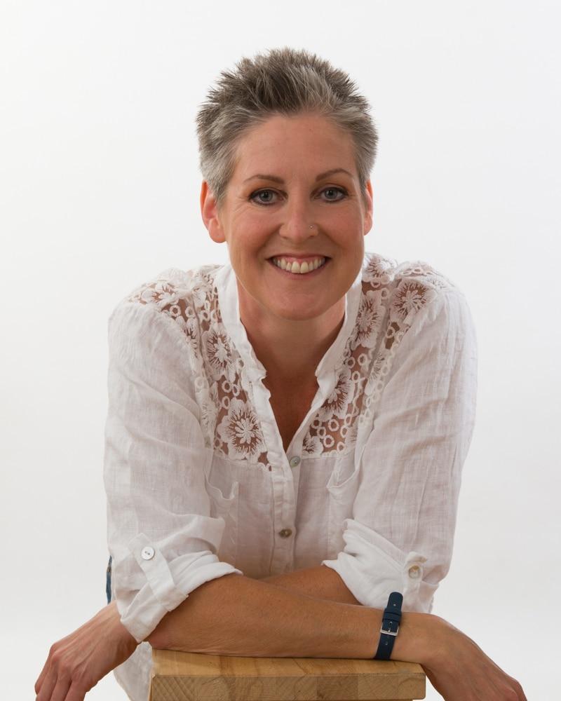 portfolio - woman in studio against a grey background