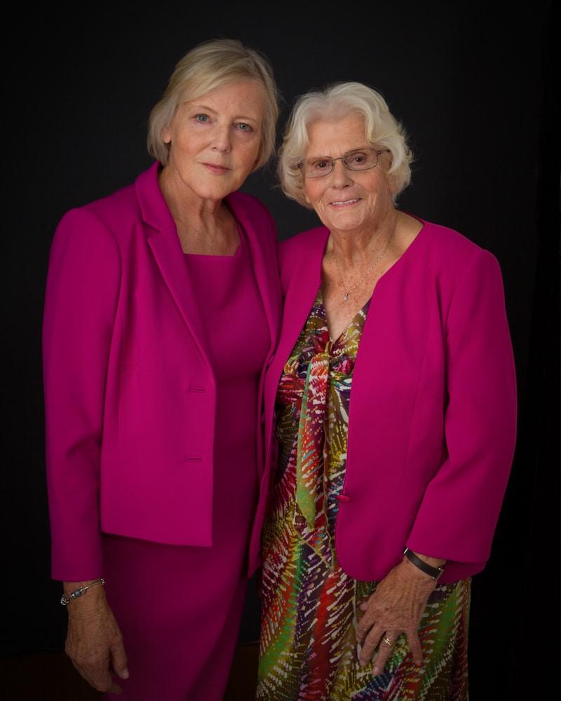 portfolio - mother and daughter in studio against a dark background