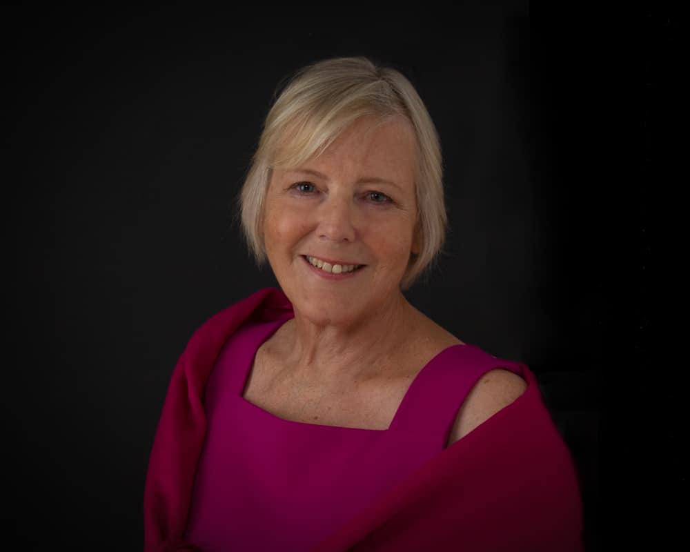 portfolio - woman in studio against a dark background